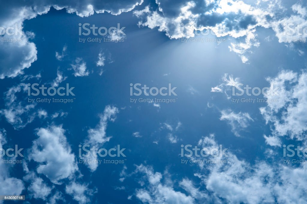 Blue cloudy sky with white gray clouds stock photo