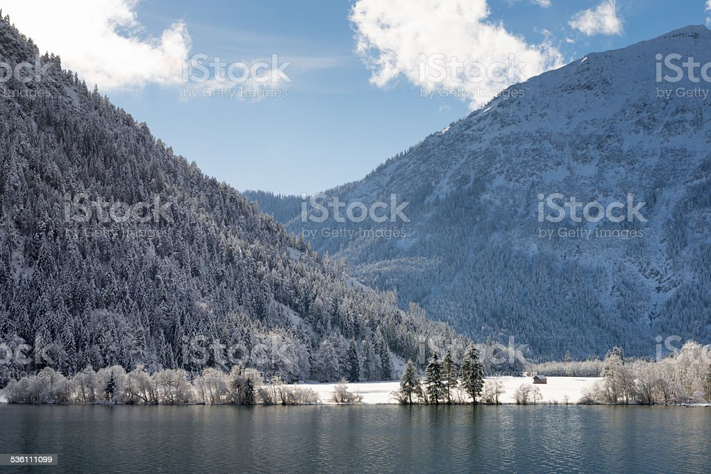 blue cloudy sky with wonderful winter landscape at lake stock photo