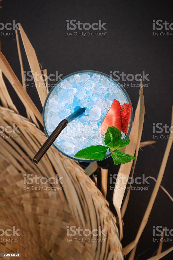 Blue Cocktail and Straw Hat stock photo