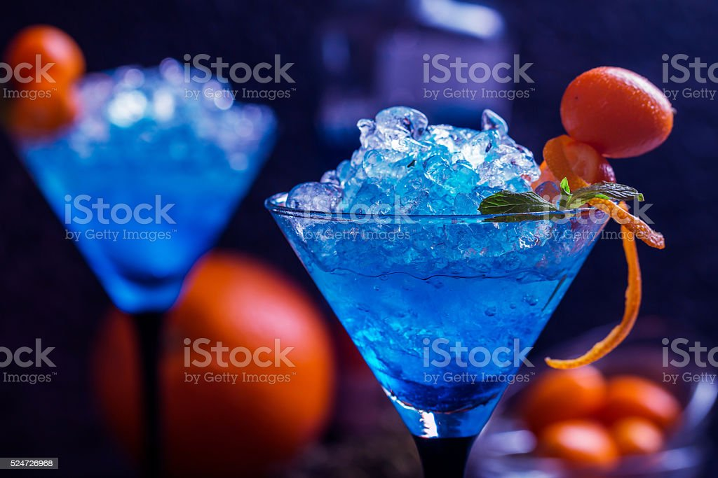 Blue cocktail in martini glasses stock photo