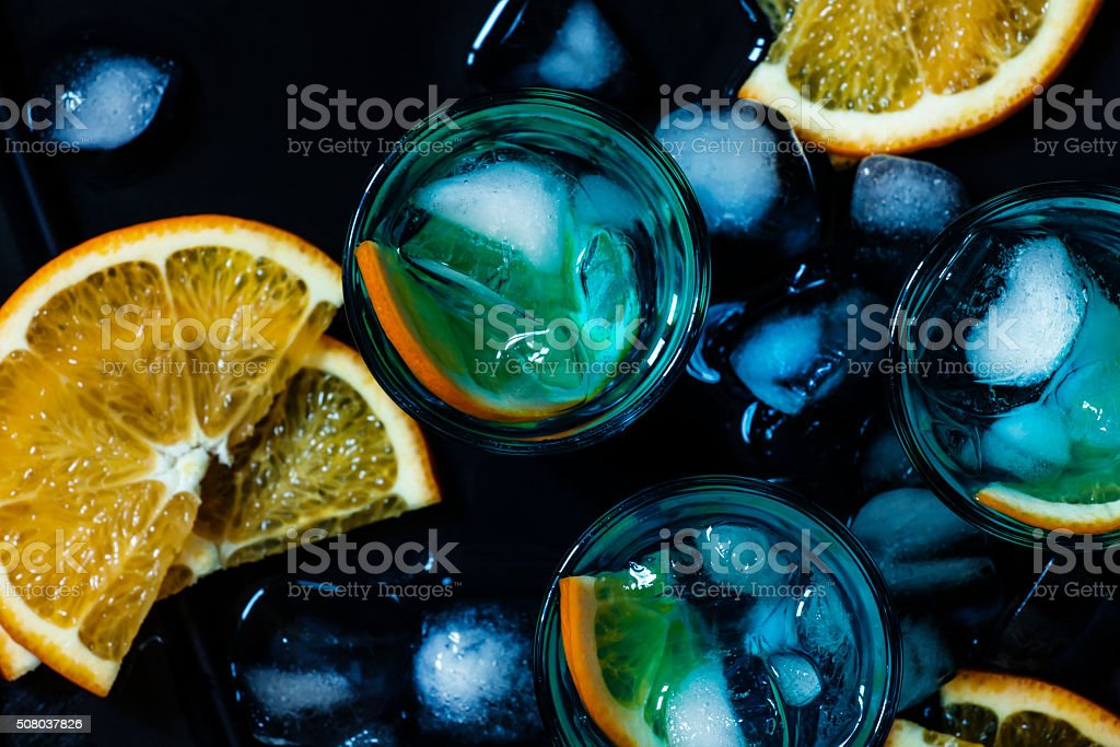 Blue cocktail with blue curacao liqueur and orange stock photo