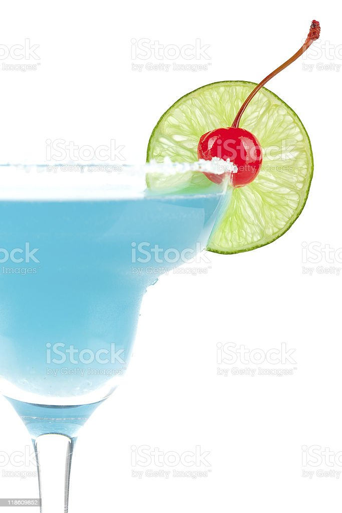 Blue cocktail with cherry and lime slice royalty-free stock photo