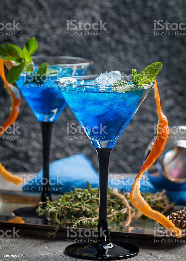 Blue cocktail with ice stock photo