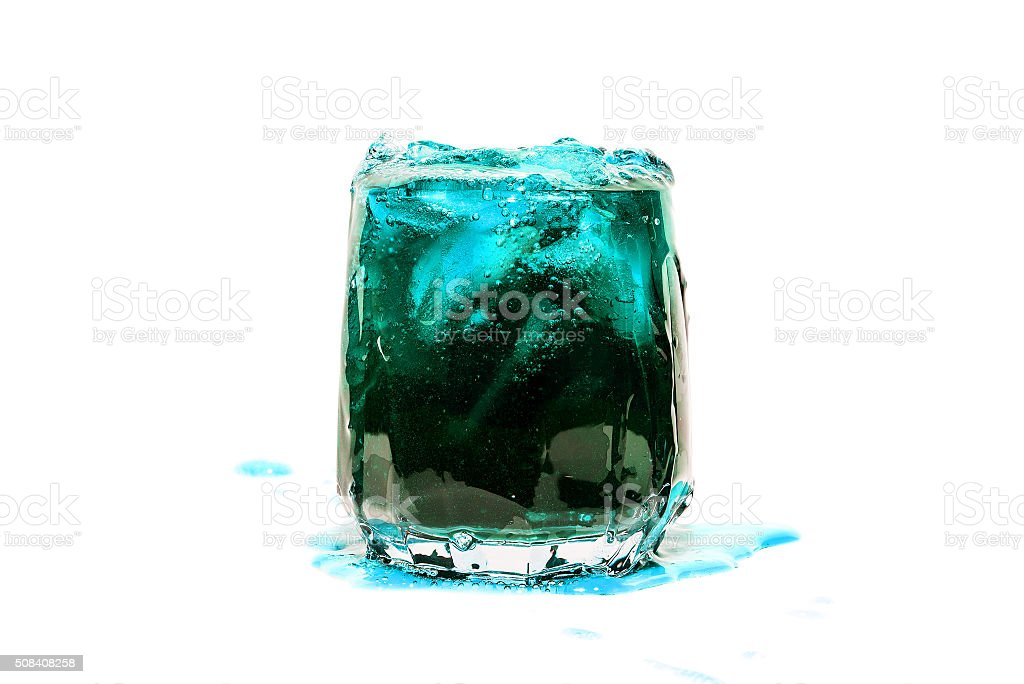blue coctail drink with ice cubs isolate stock photo