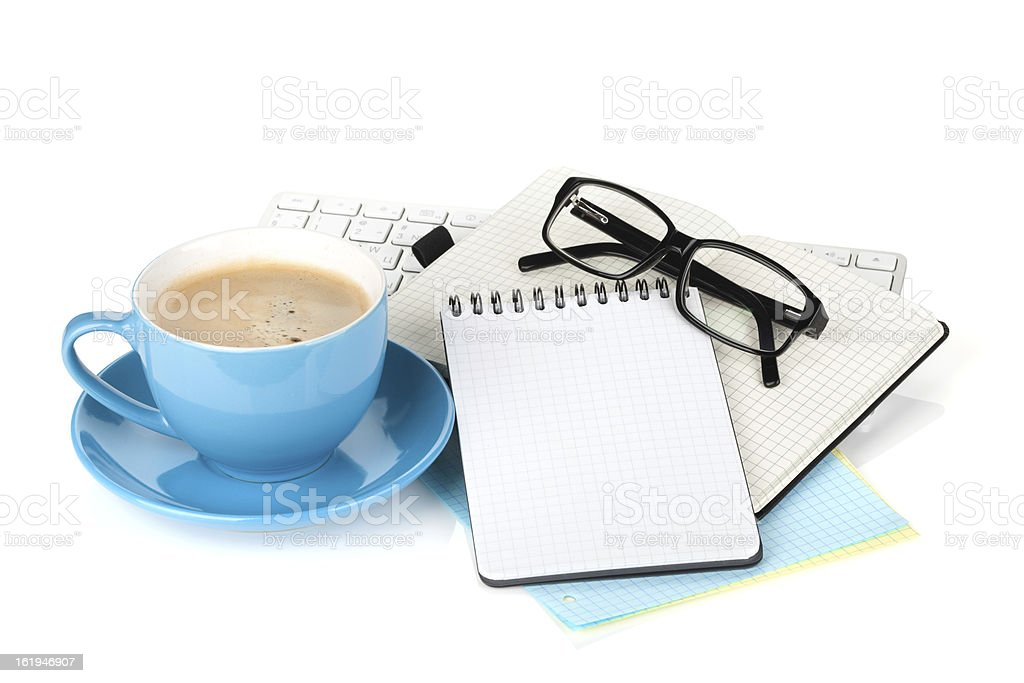 Blue coffee cup, glasses and office supplies royalty-free stock photo