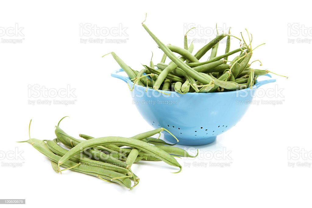 blue colander with long green beans stock photo