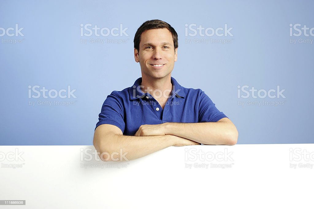 Blue Collar Businessman Leaning on White Board stock photo