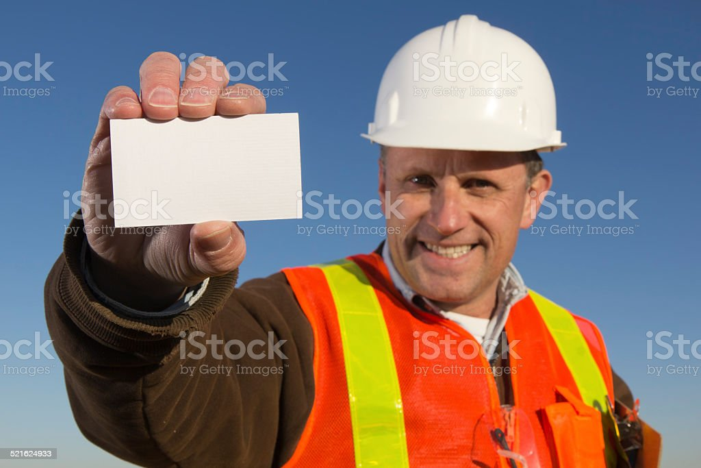 Blue Collar Worker and Blank Business Card stock photo
