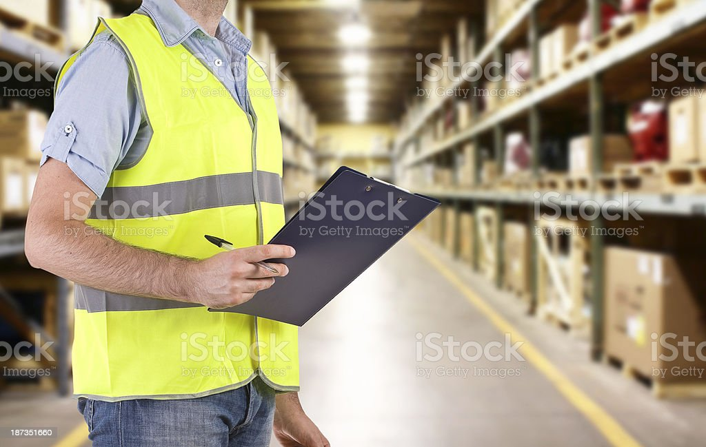 A blue collar worker and his clipboard taking notes stock photo