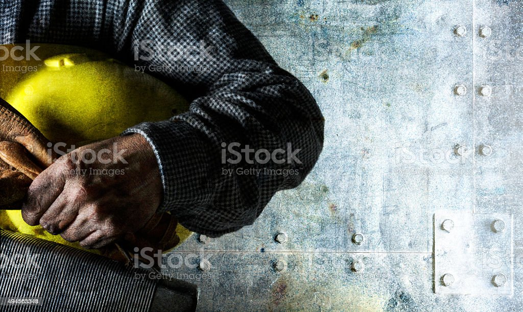 Blue Collar Worker Holding Lunch Pail and Hard Hat stock photo