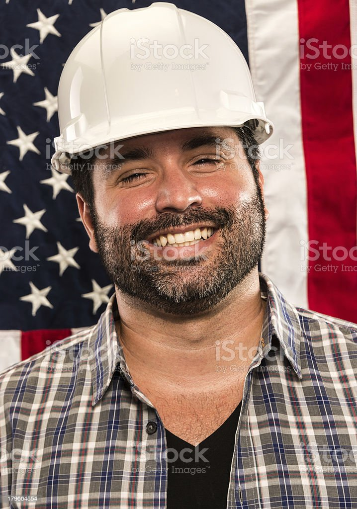 Blue Collar Worker Portrait in Front of An American Flag royalty-free stock photo