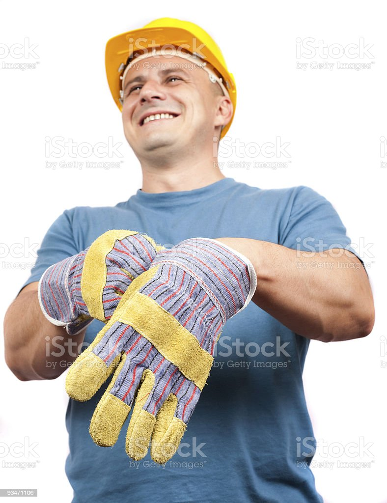 Blue collar worker putting on leather protection gloves royalty-free stock photo