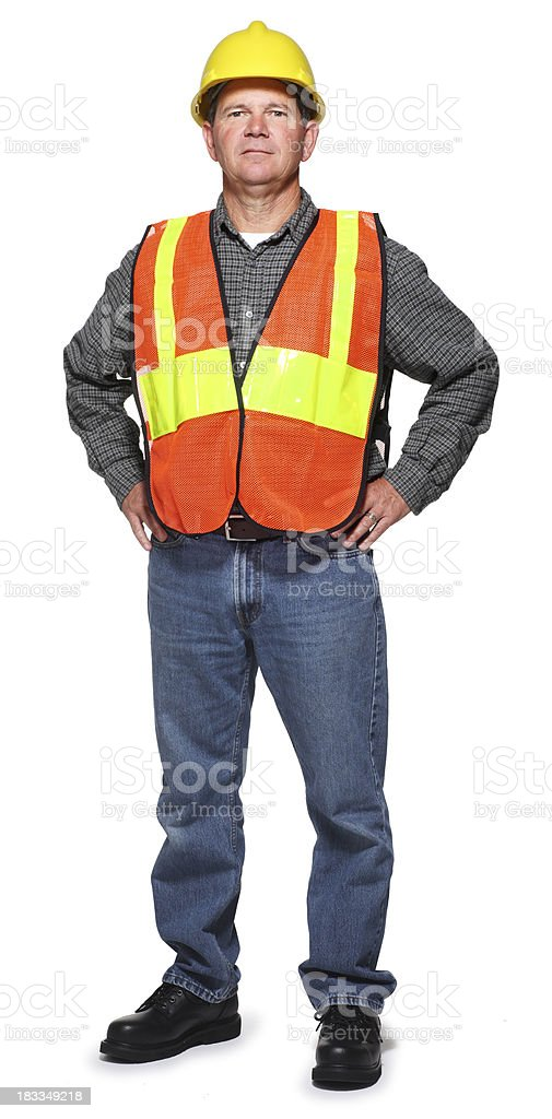 Blue collar worker wearing safety vest and hard hat royalty-free stock photo