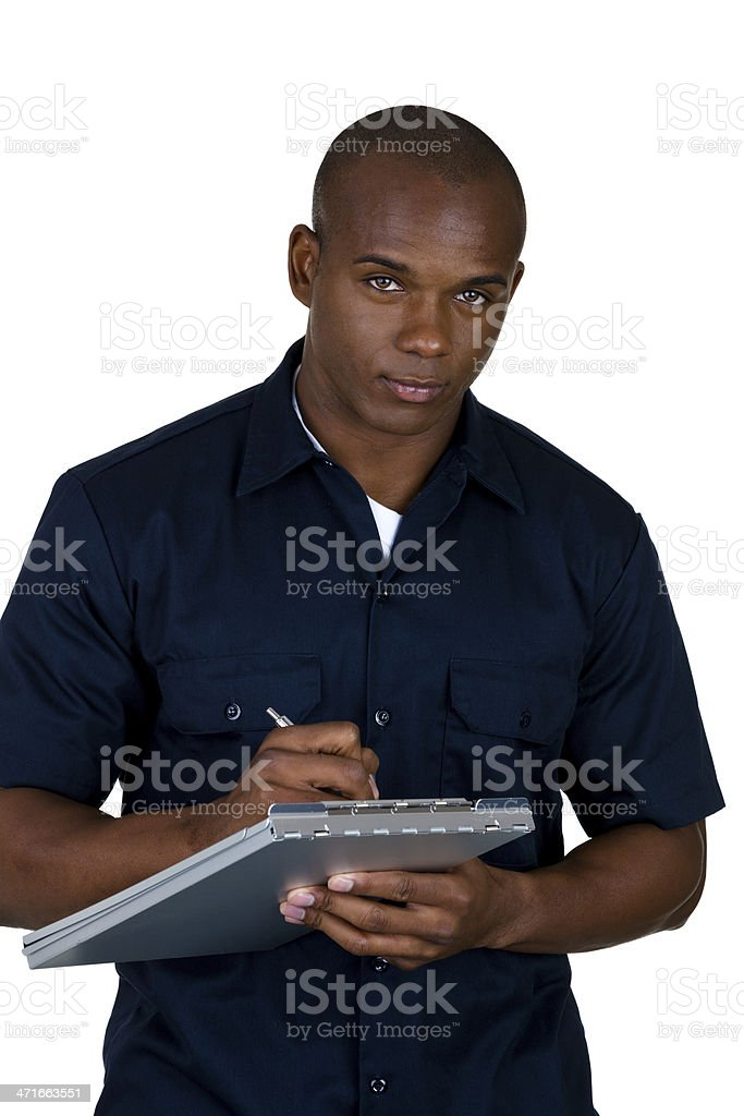 Blue collar worker writing estimate royalty-free stock photo
