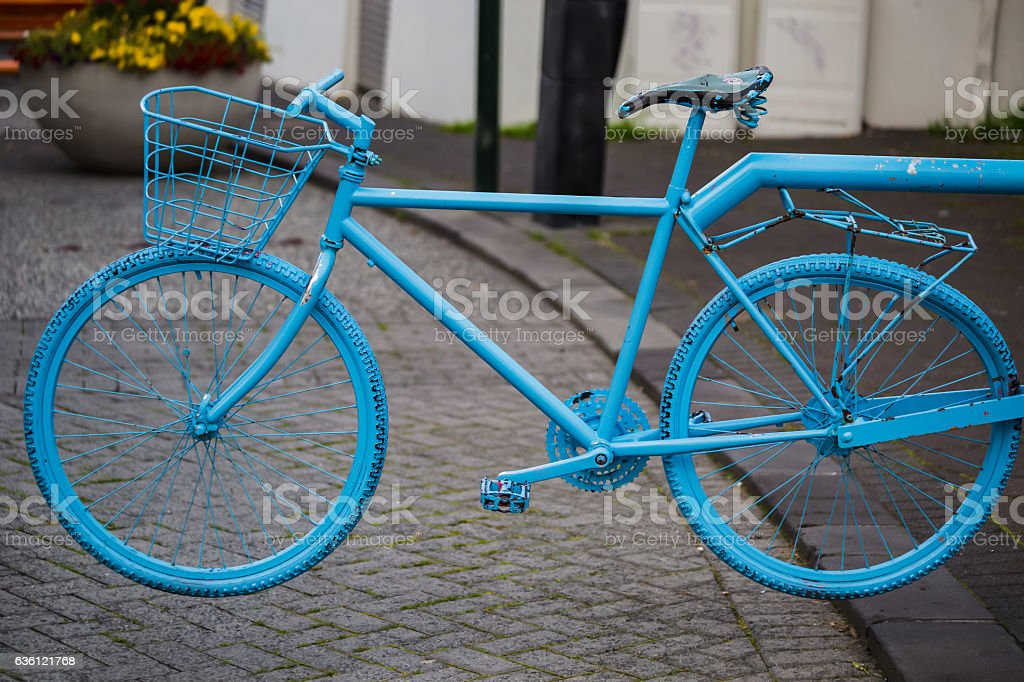 Blue colored bike at a street stock photo