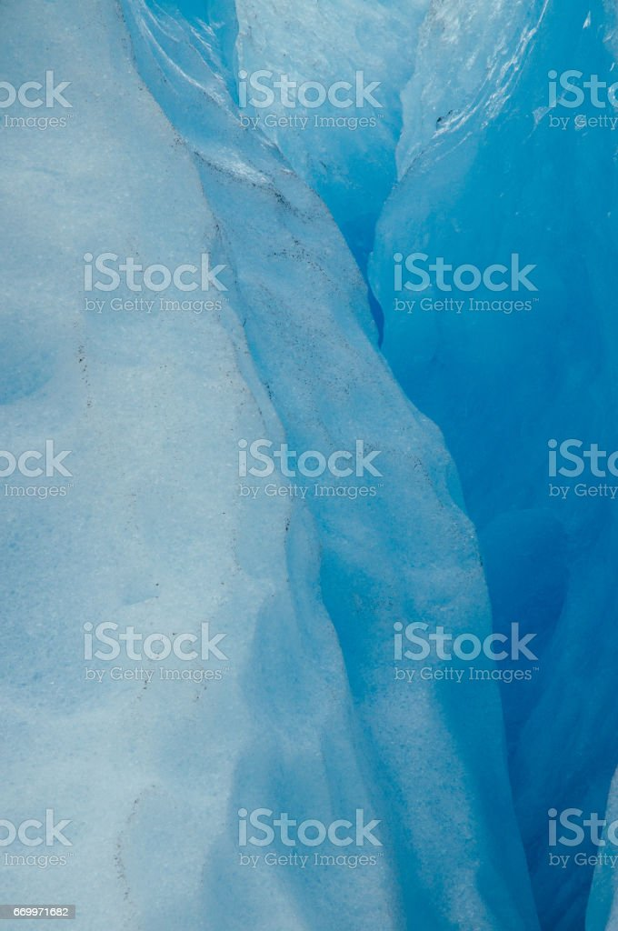 Blue colors of ice inside glacier stock photo