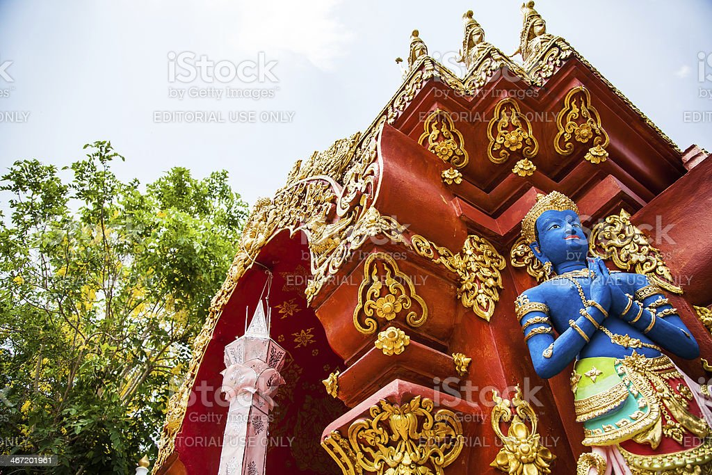Blue coloured Buddha statue at the temple stock photo