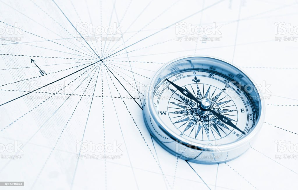 Blue compass high key stock photo