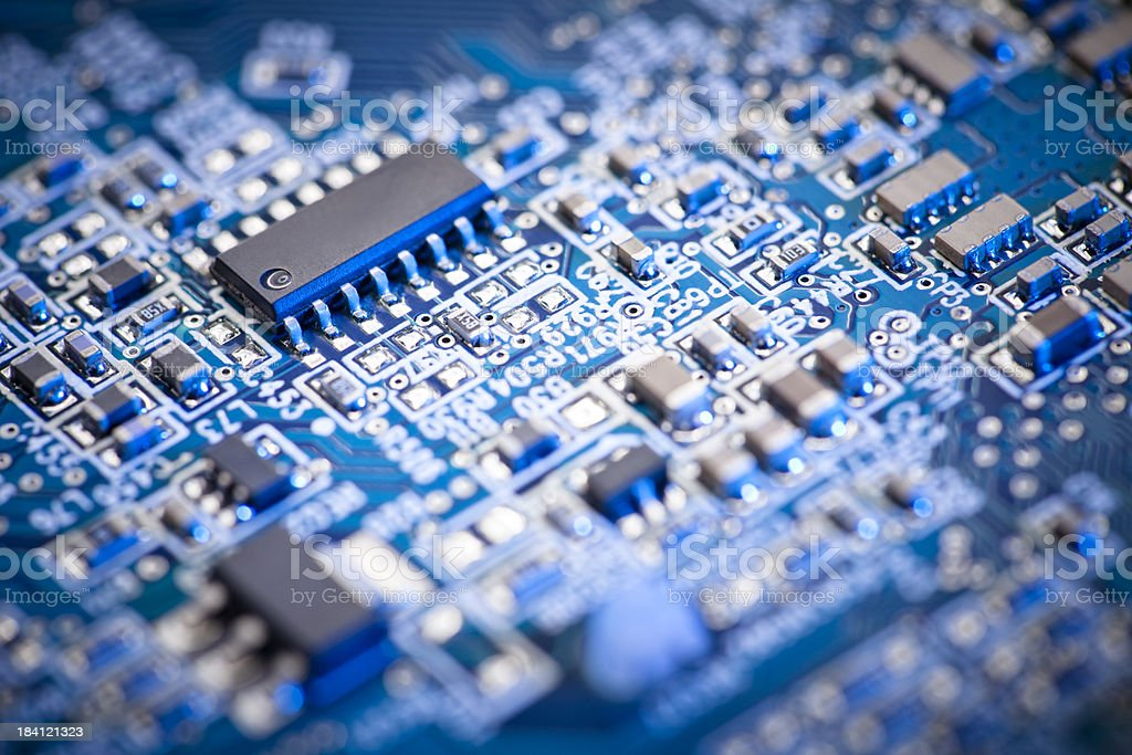Blue computer circuit board focus set on microchip stock photo