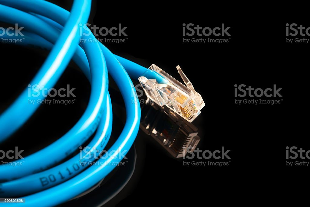 Blue computer ethernet cable isolated on black background, close-up stock photo