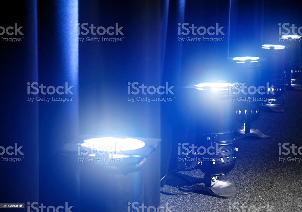 Blue concert PAR lights on floor stock photo
