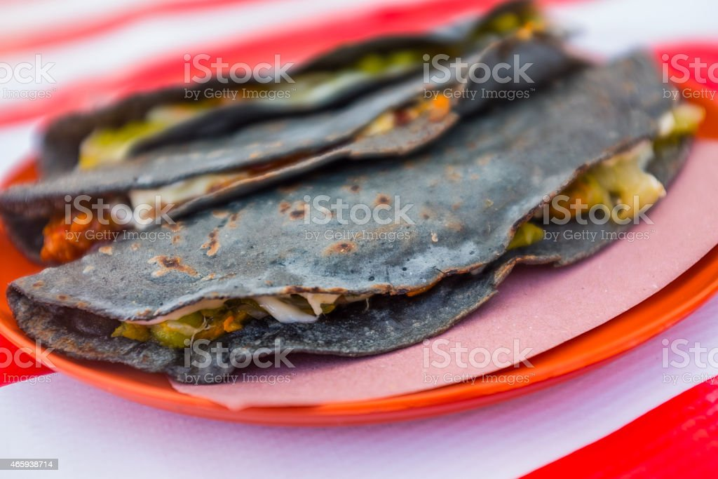Blue corn quesadilla with squash blossom an cheese stock photo