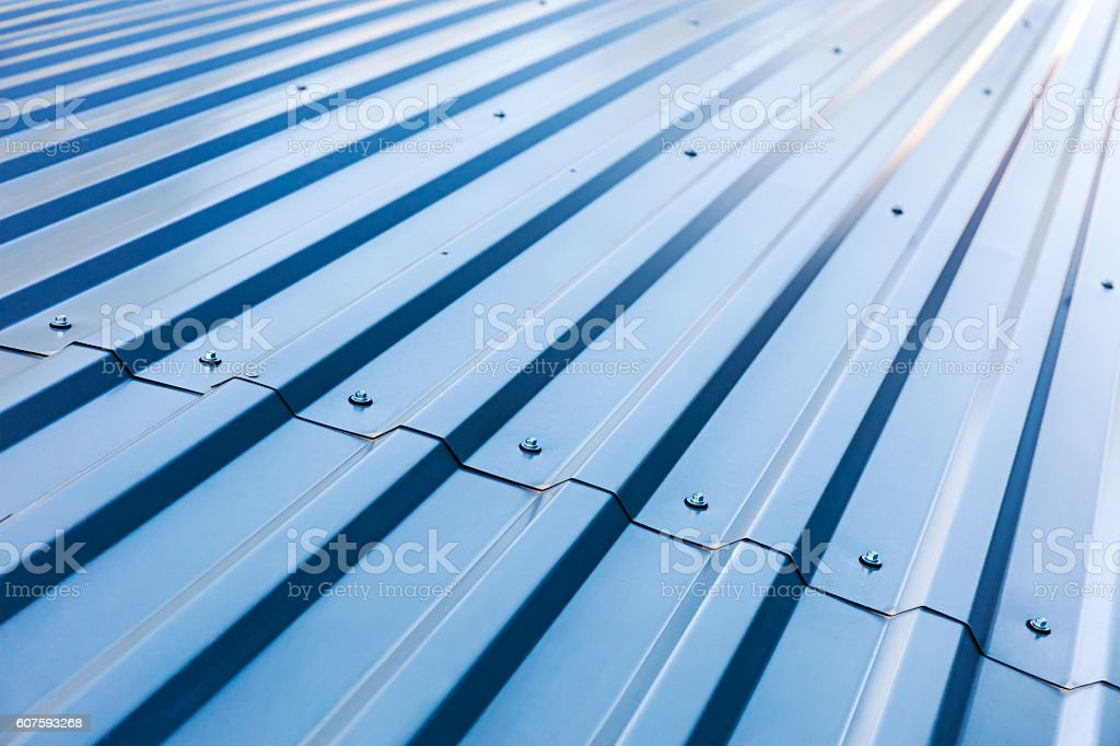 blue corrugated metal roof with rivets stock photo