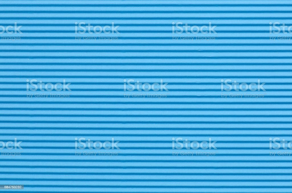 blue corrugated paper background texture stock photo
