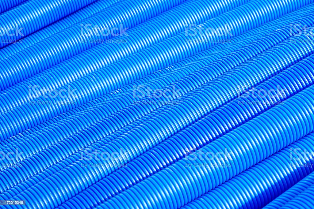 Blue corrugated pipe for electrical high-voltage cables stock photo