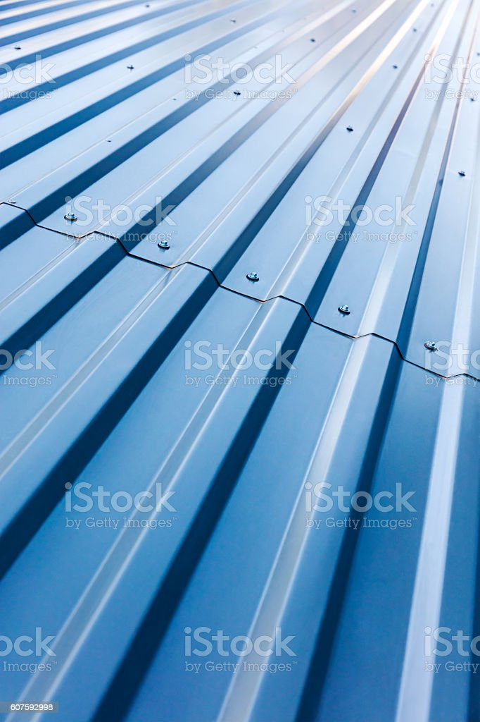 blue corrugated steel roof with rivets stock photo