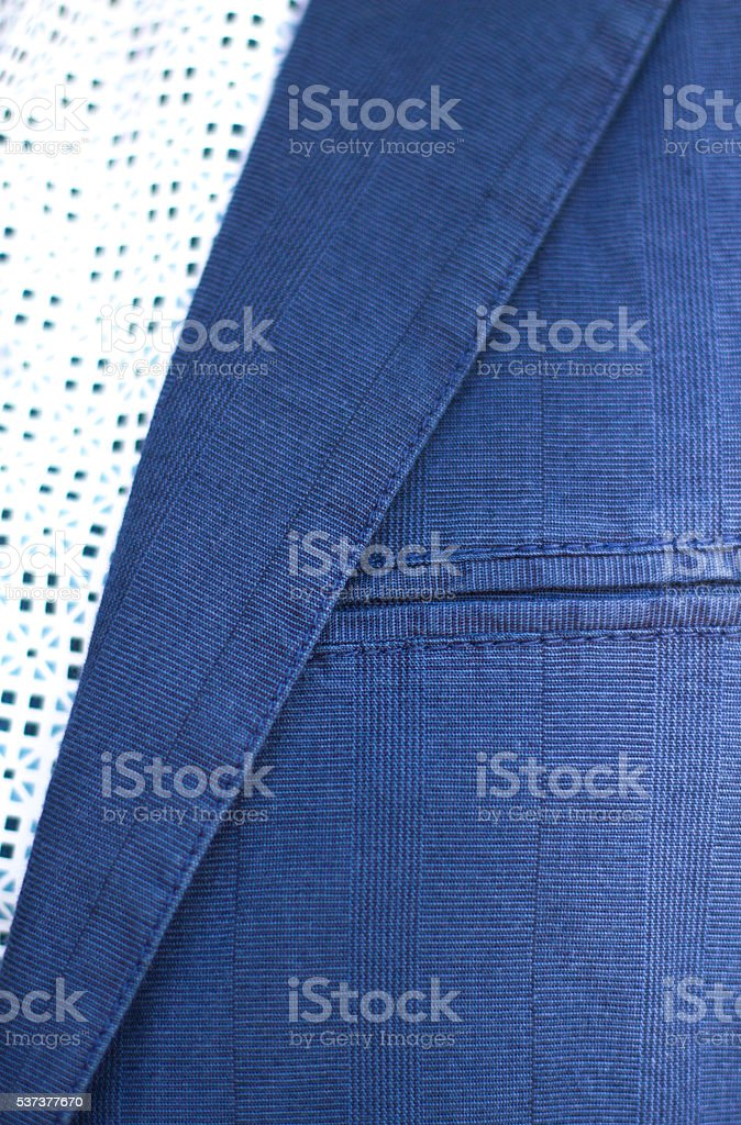 Blue Cotton Men's Sports Jacket Lapel and Breast Pocket (Close-Up) stock photo