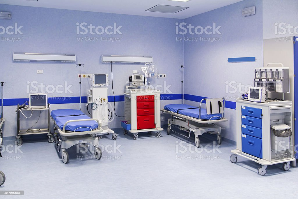 blue covered hospital beds stock photo
