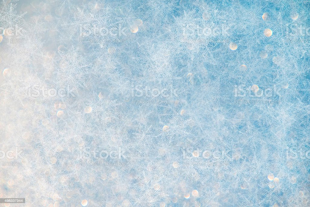 Blue cracked cold ice abstract background for christmas and winter stock photo