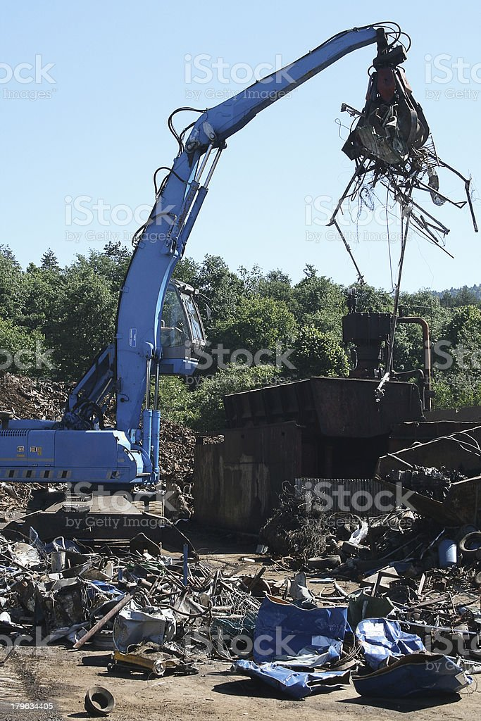 Blue crane in a metal recycling plant stock photo