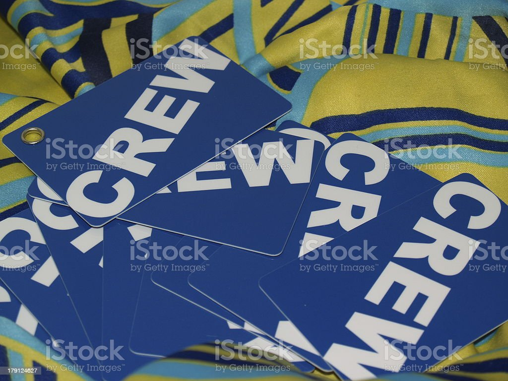 Blue crew cards on the blue-yellow background royalty-free stock photo