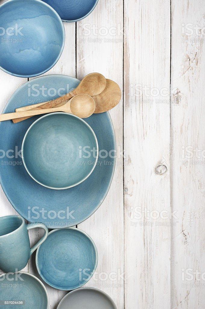 Blue crockery on white wood stock photo