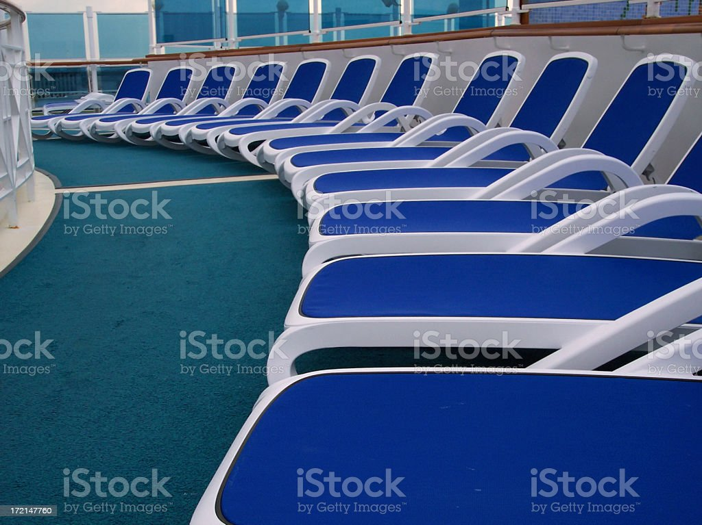 Blue Cruise Ship Deck Chairs Curved royalty-free stock photo
