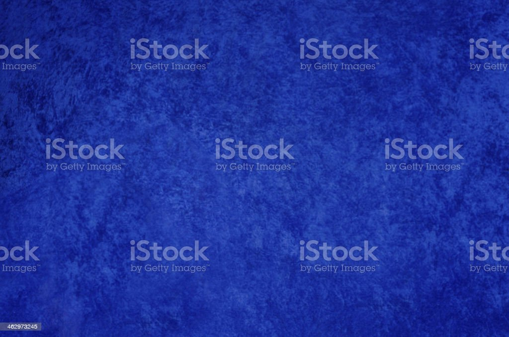 Blue crushed velvet background, slightly defocussed. stock photo