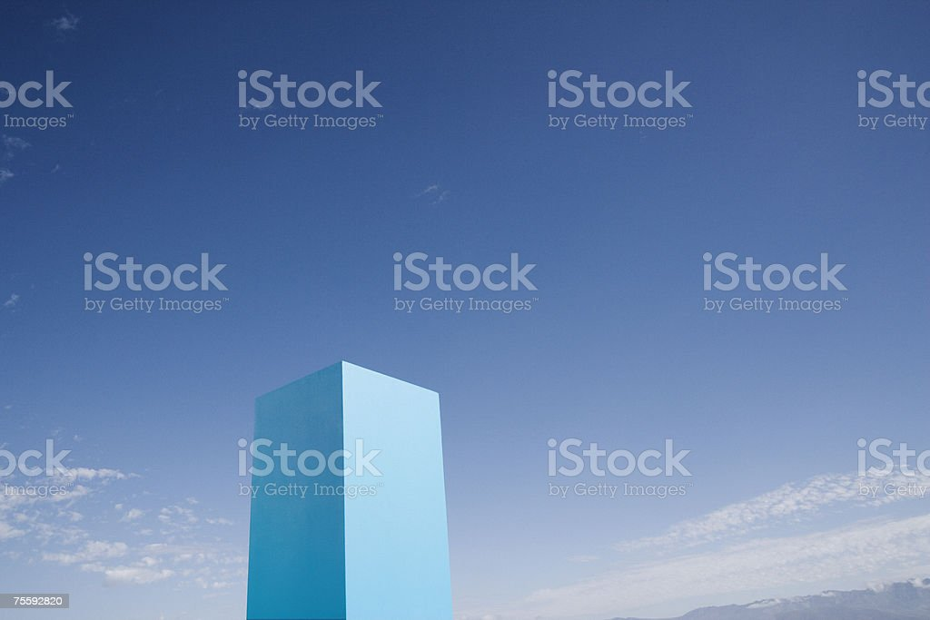 Blue cube set against sky royalty-free stock photo