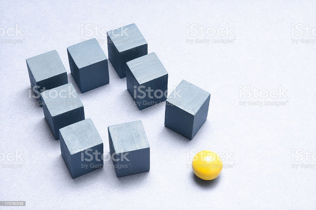 Blue cubes and yellow sphere stock photo