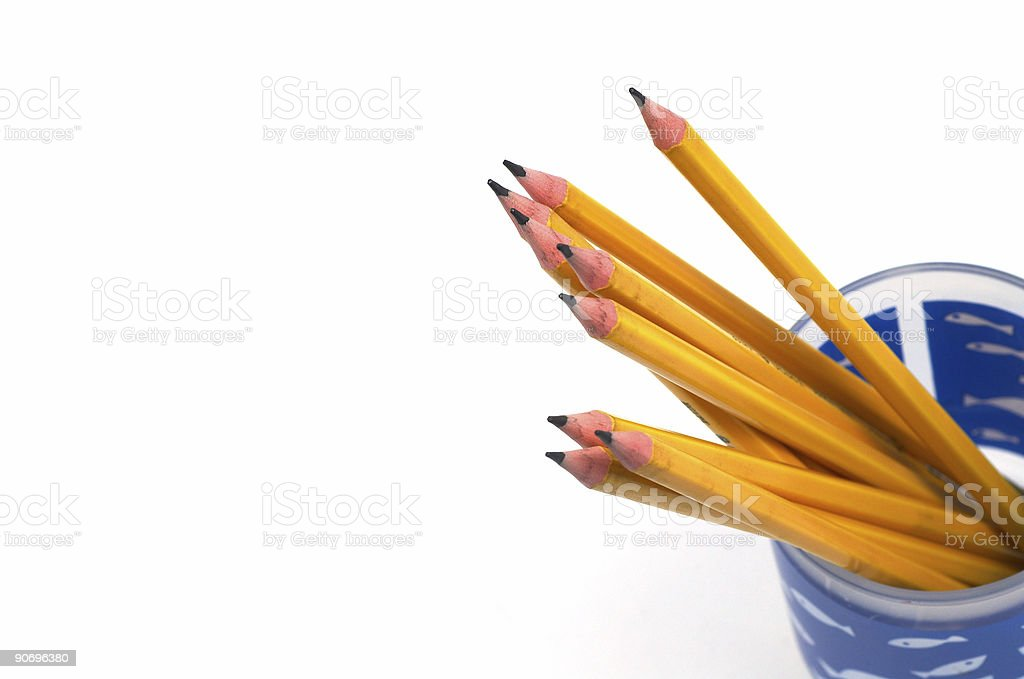 Blue cup of sharpened pencils on white background royalty-free stock photo