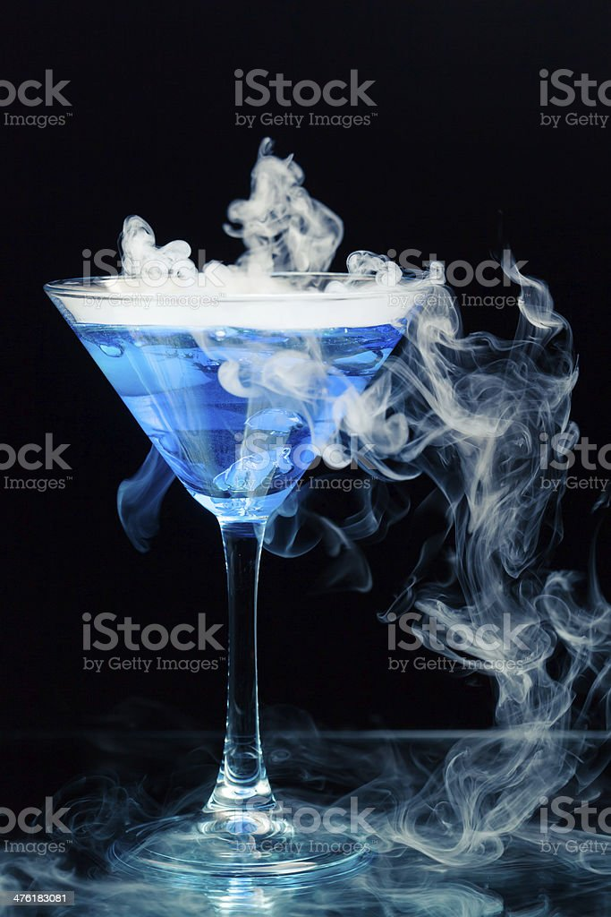 blue curacao cocktail with splash stock photo
