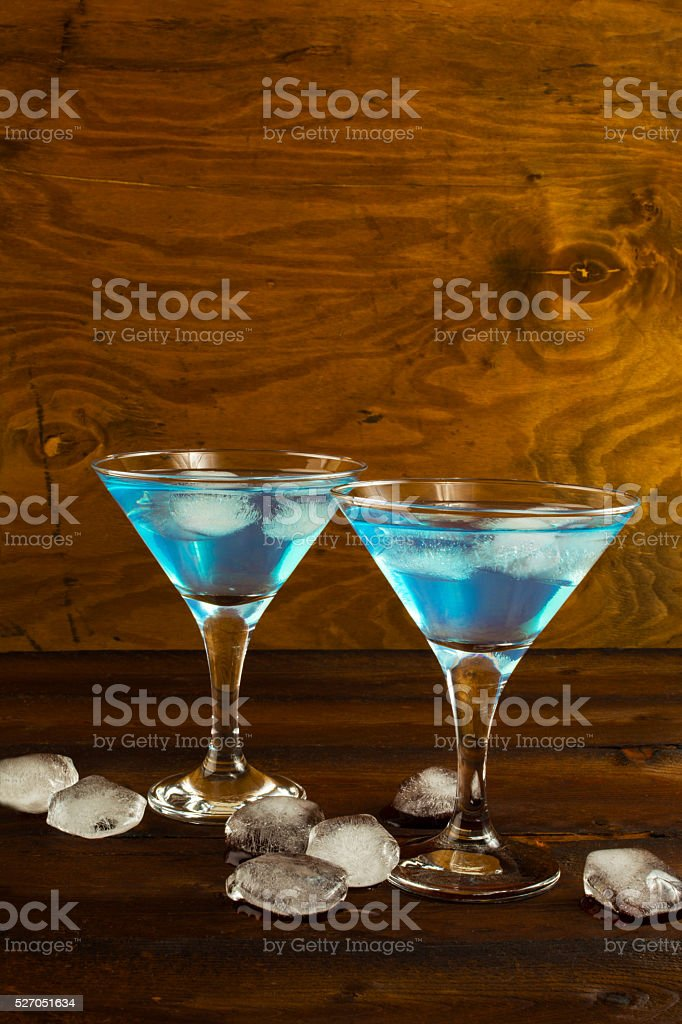 Blue Curacao liqueur cocktail in a martini glasses stock photo