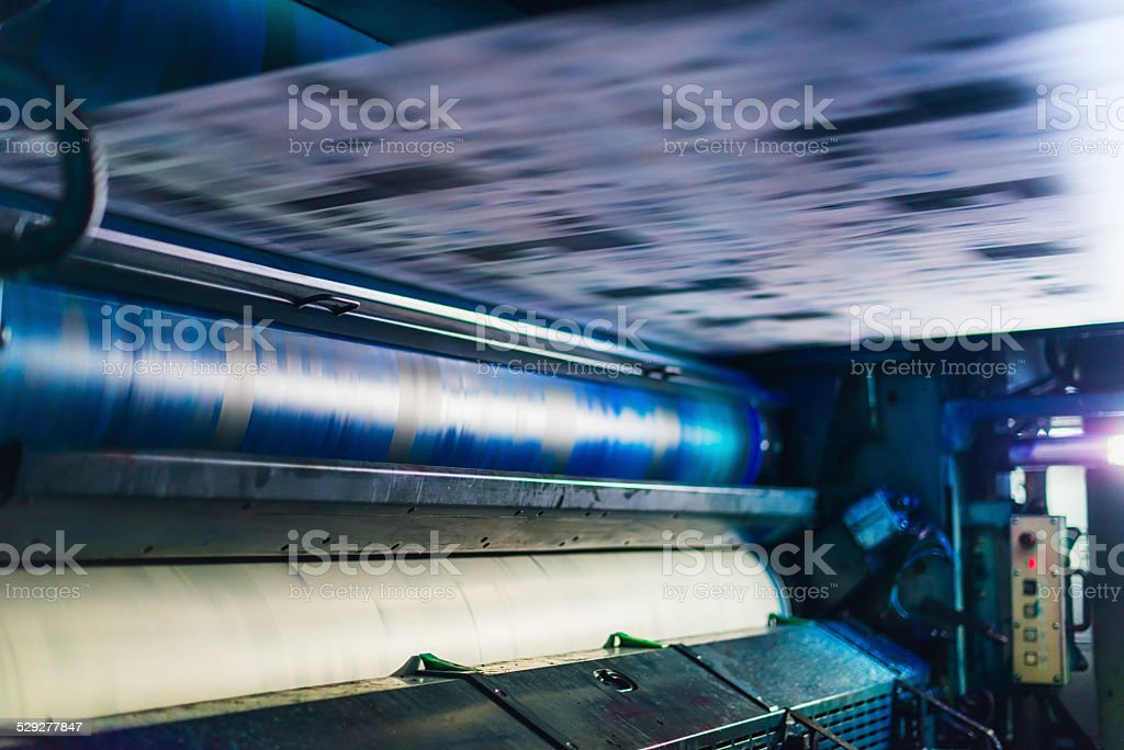 blue cyan colour cylinder in cmyk web offset printing press stock photo