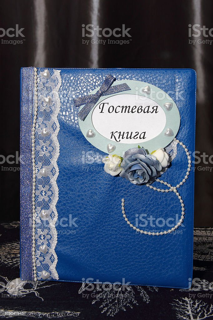 Blue decorated wedding guest book stock photo