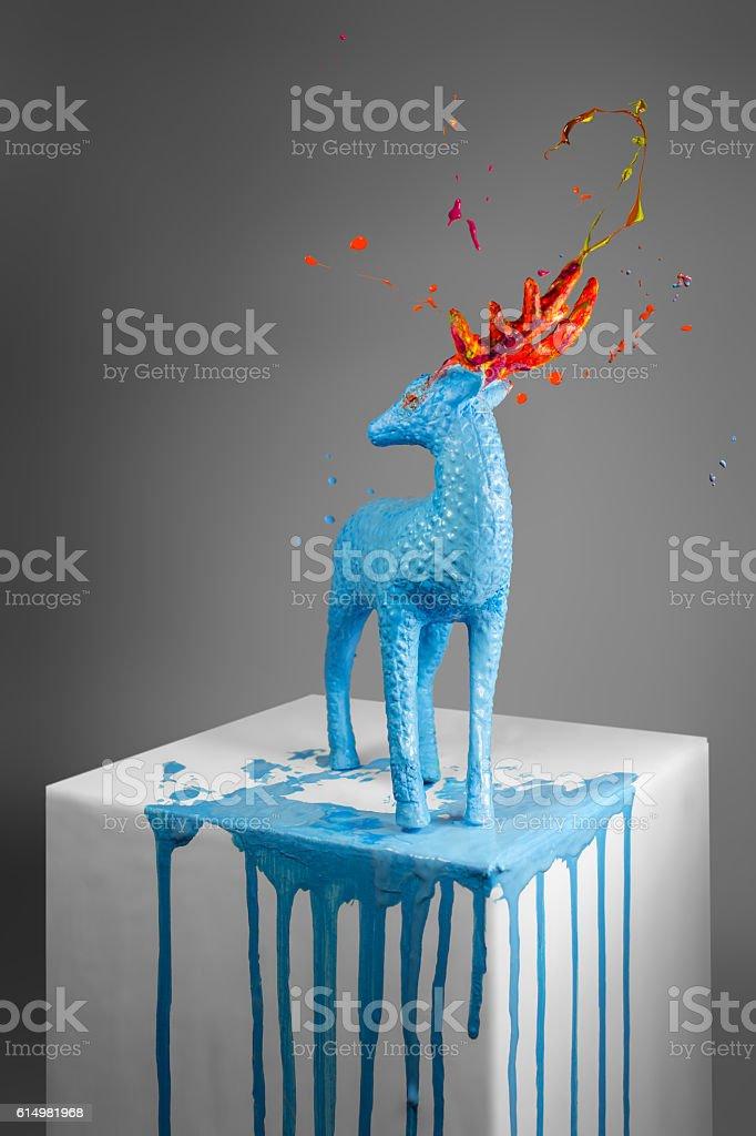 Blue deer sculpture with a magic horns stock photo