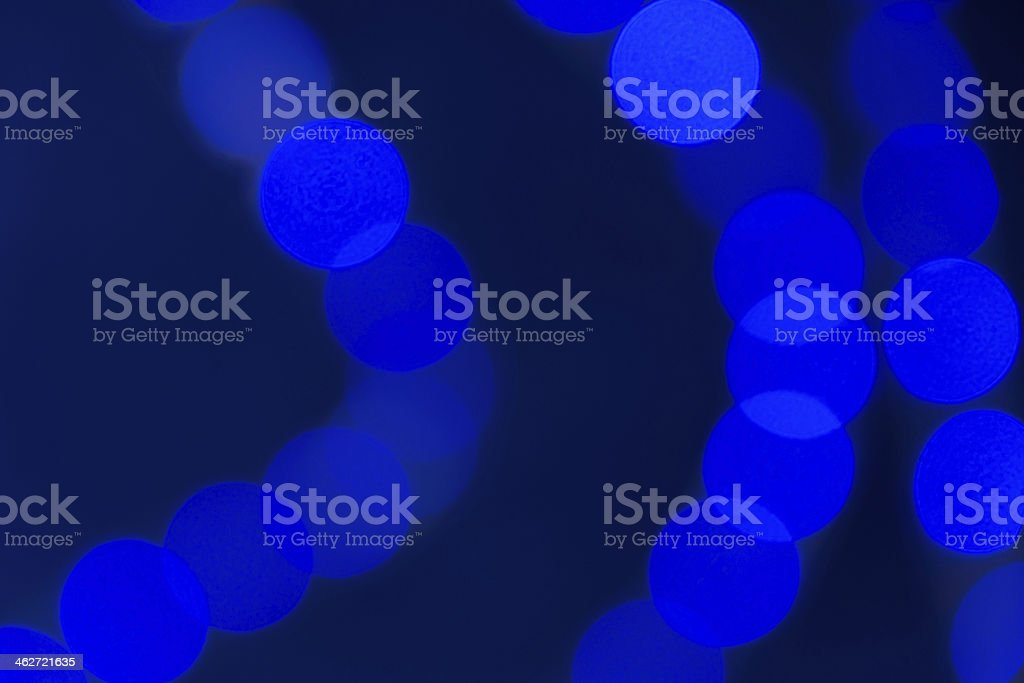 Blue defocused Christmas rope lights. stock photo