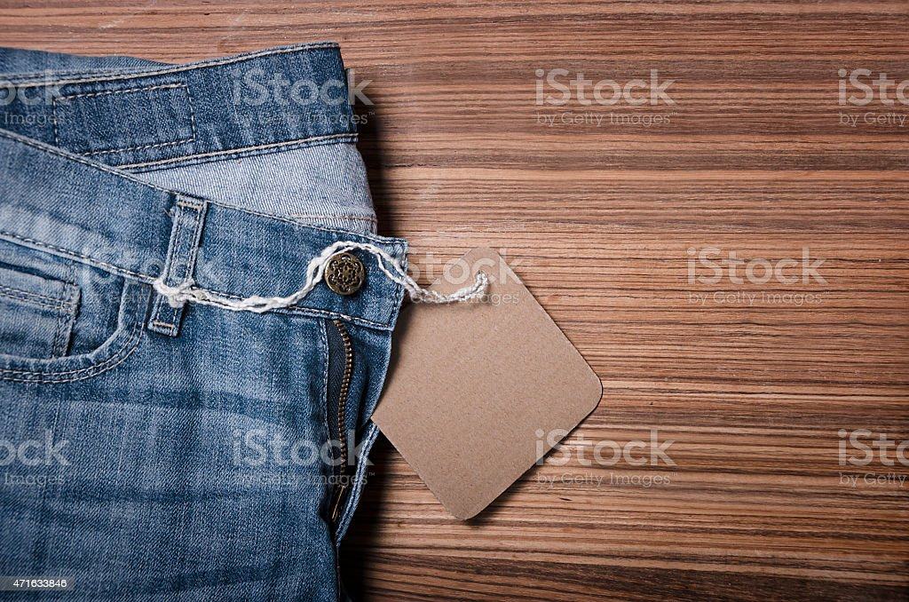 blue denim jeans with paper label stock photo