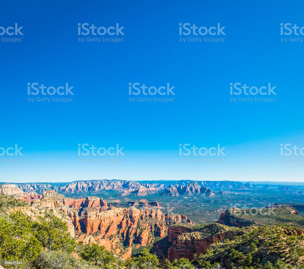 Blue desert sky over red rock ponderosa country Sedona Arizona stock photo
