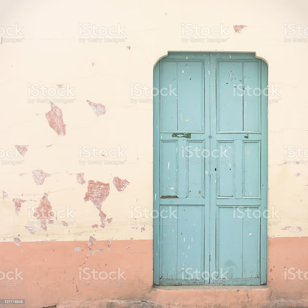 Blue doer on pink grunge wall royalty-free stock photo